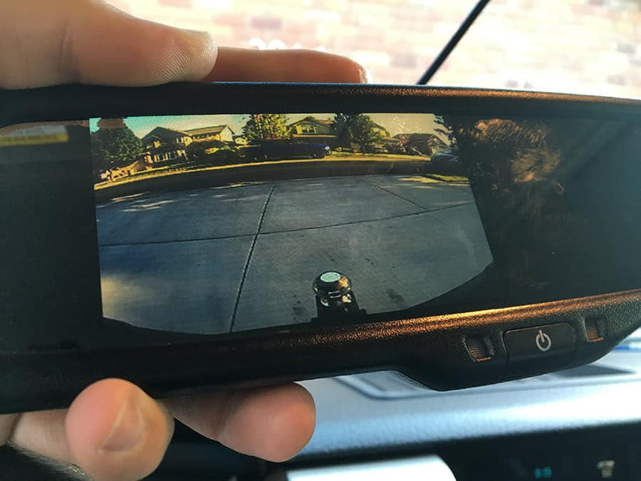 Backup camera mirror being held in hand to show size.