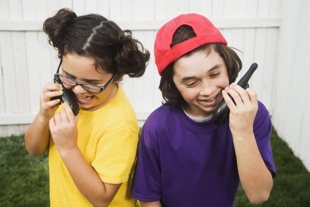Children talk on walkie talkies.