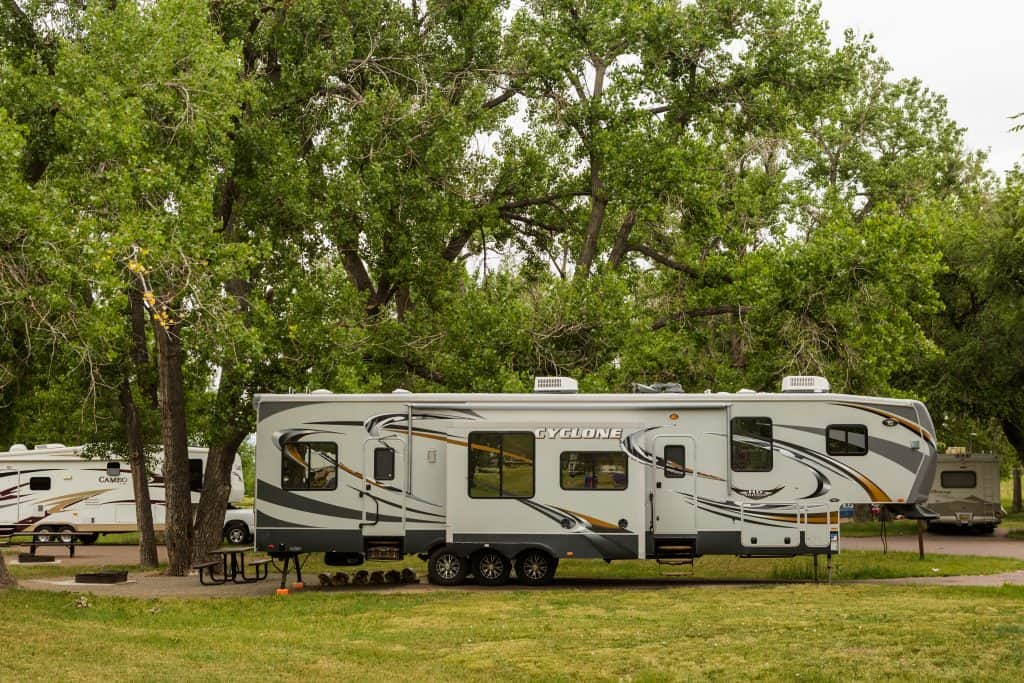 Huge 5th wheel set up at public campground.