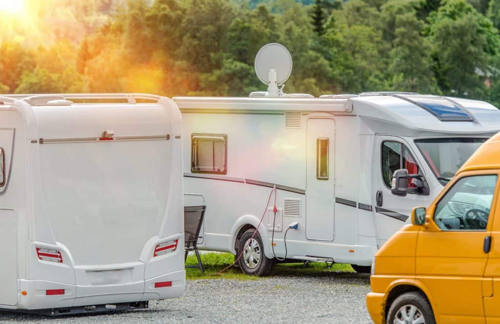 Motorhomes closely parked at small RV campground.