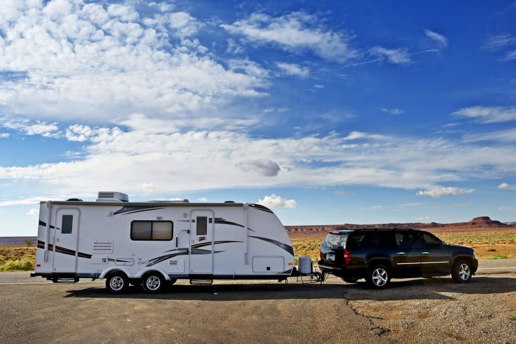 SUV towing camper trailer