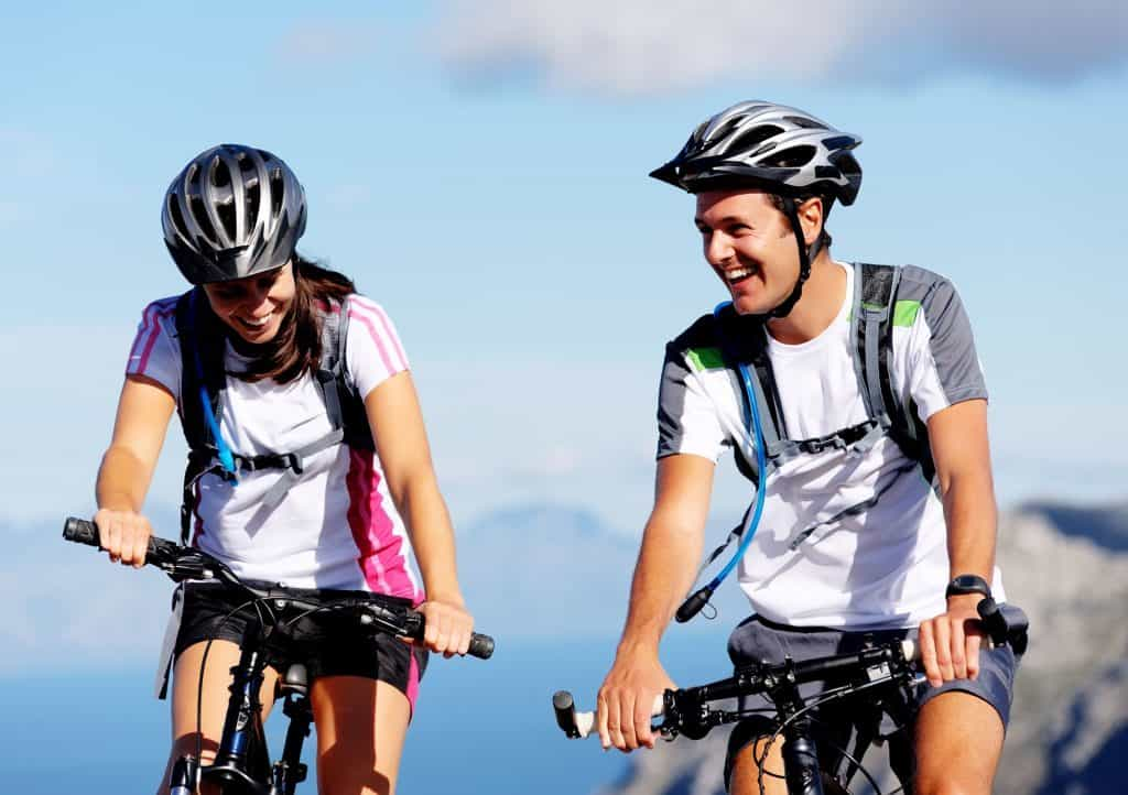 Young man and woman riding mountain bikes.