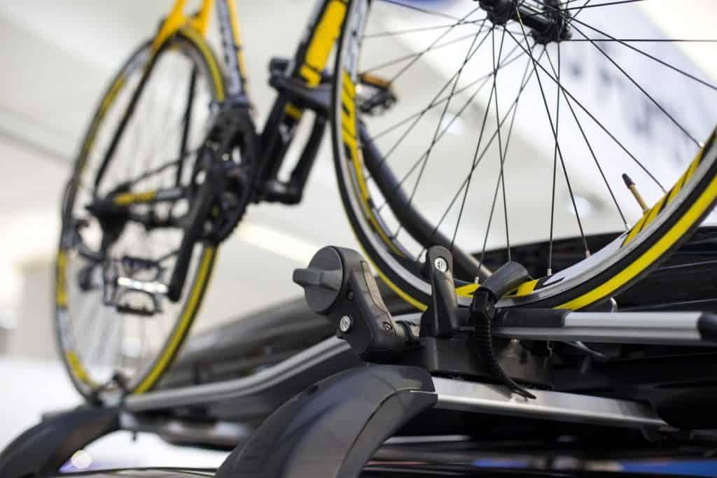 Racing bicycle mounted on roof rack.