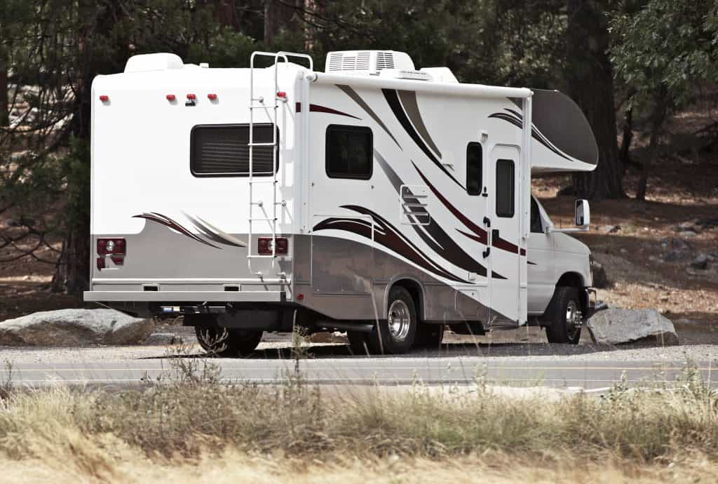 Small Class C RV parked at National Park.
