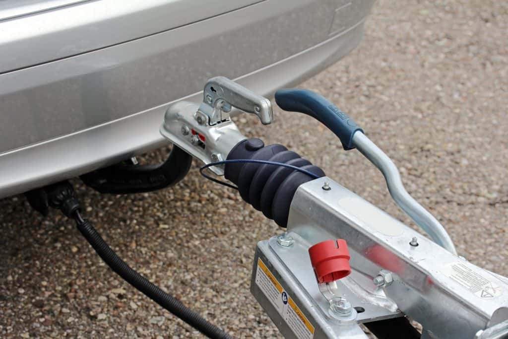 Close up of trailer hitch attached to vehicle.