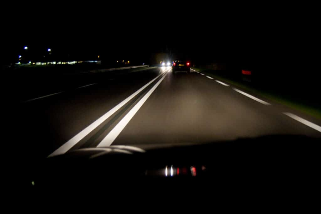 Dark highway with approaching lights