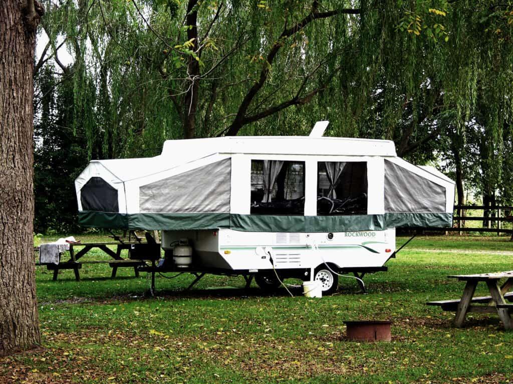 Rockwood pop-up camper setup in public campground.