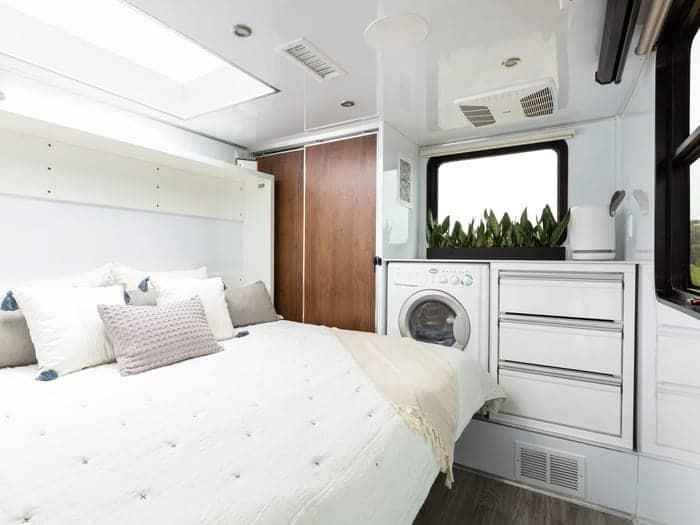 Luxury bedroom in a 2021 living vehicle camper.