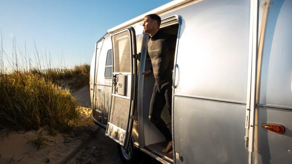 2020 Airstream Bambi with man standing in doorway.