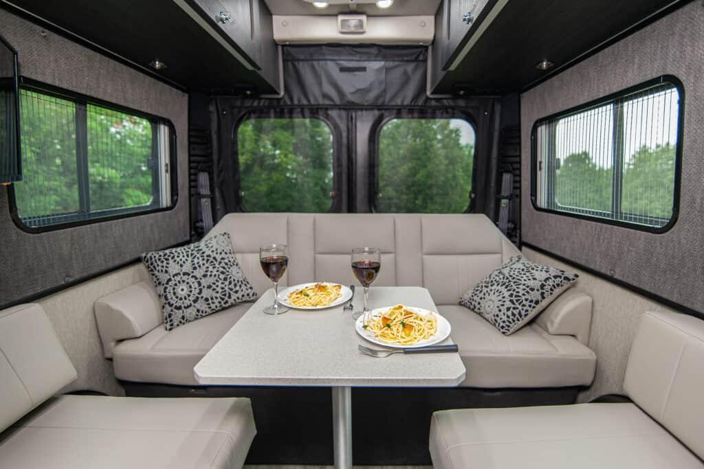 Roadtrek RV's Comfortable interior with dinner setting.