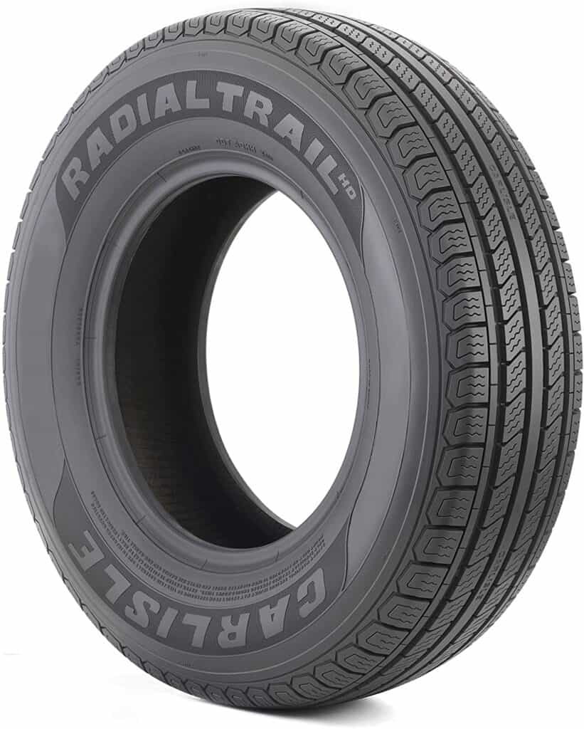 A stock photo of an unmounted radial tire by Carlisle.