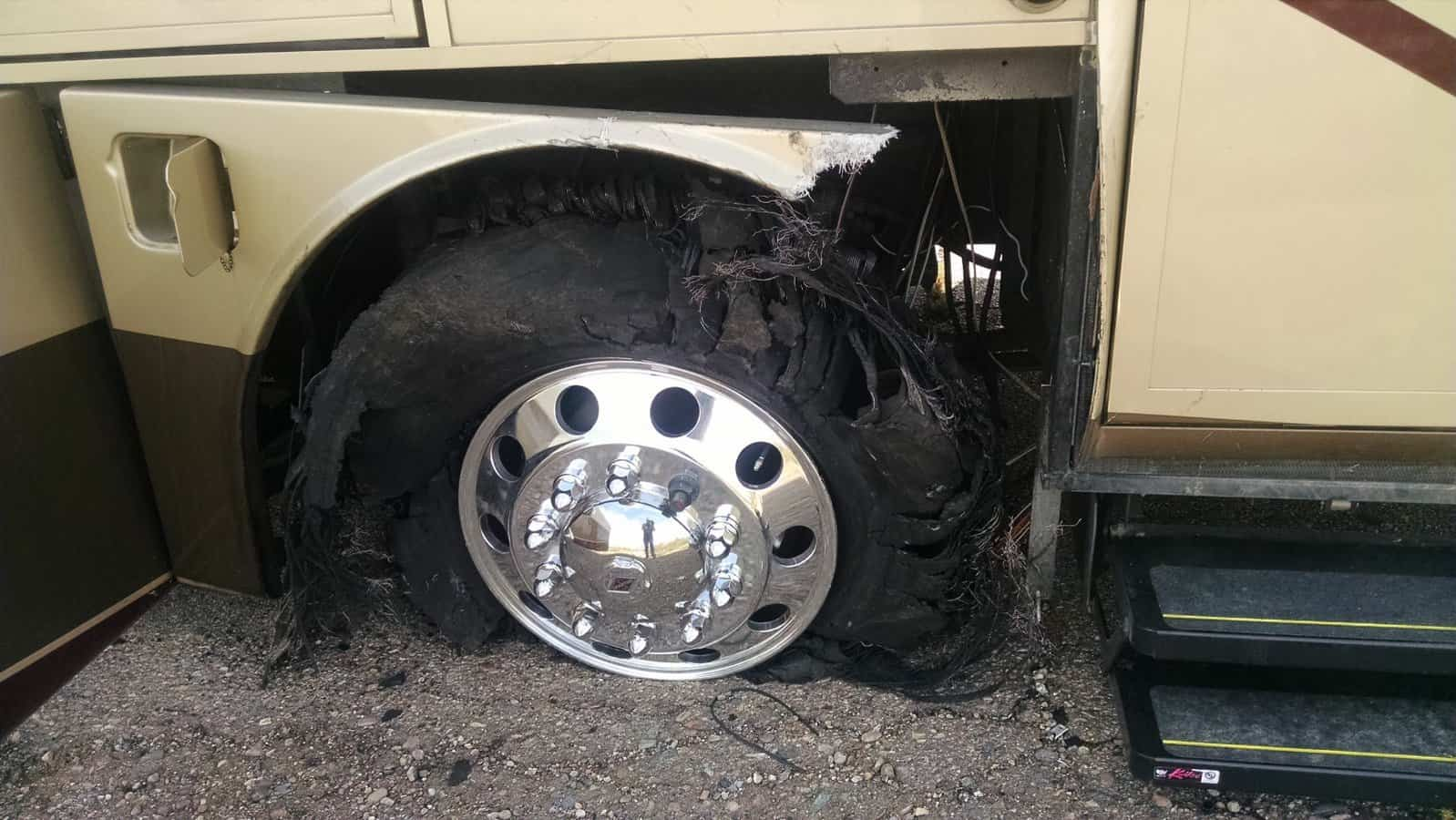 Shredded front tire on a motorhome.