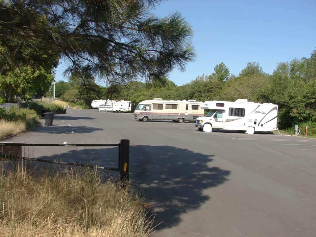 3 RVs in designated RV parking area.