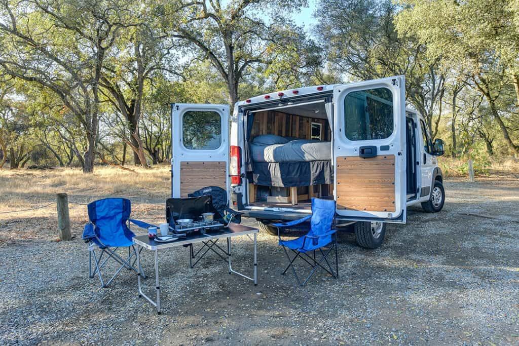 Class B camper van setup at campsite.