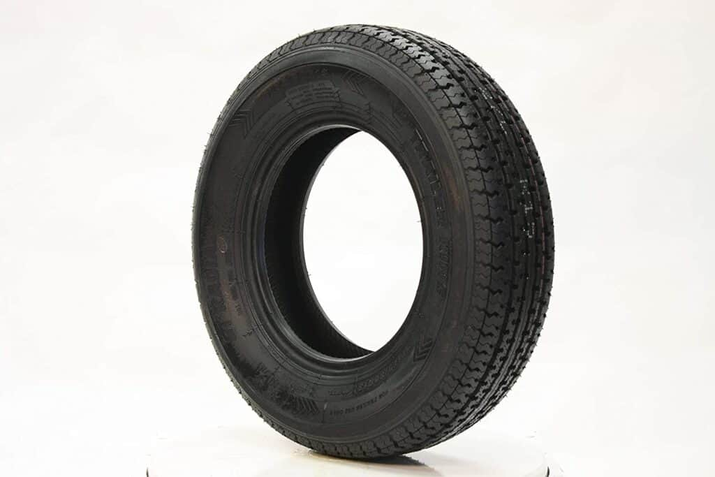A stock photo of an unmounted radial tire by Trailer King.