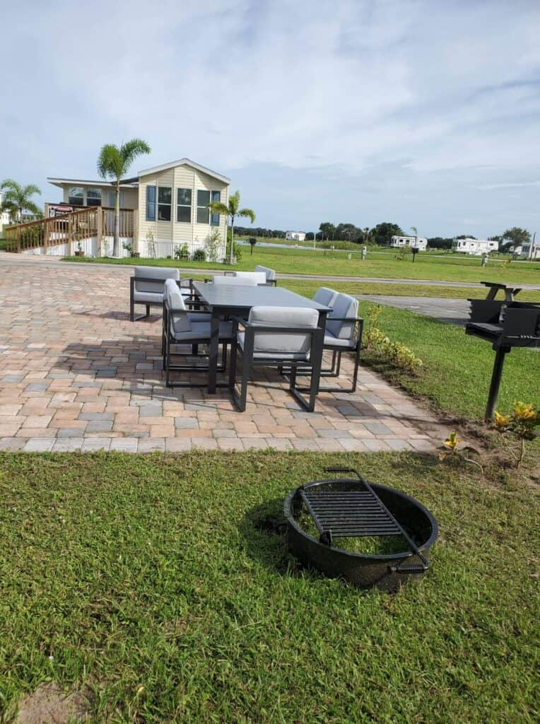 RV site with patio deck and park model at Moore Haven KOA.
