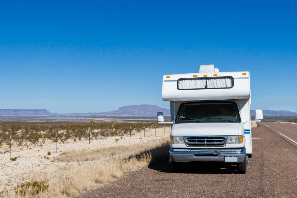 Class C RV parked on side of the road