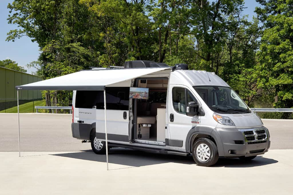 Dodge Class B camper opened for demonstration.