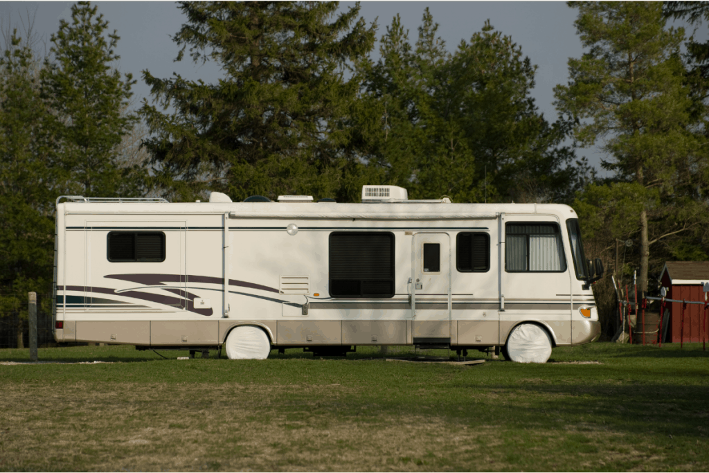 Class A motorhome with Tire covers over camper tires.