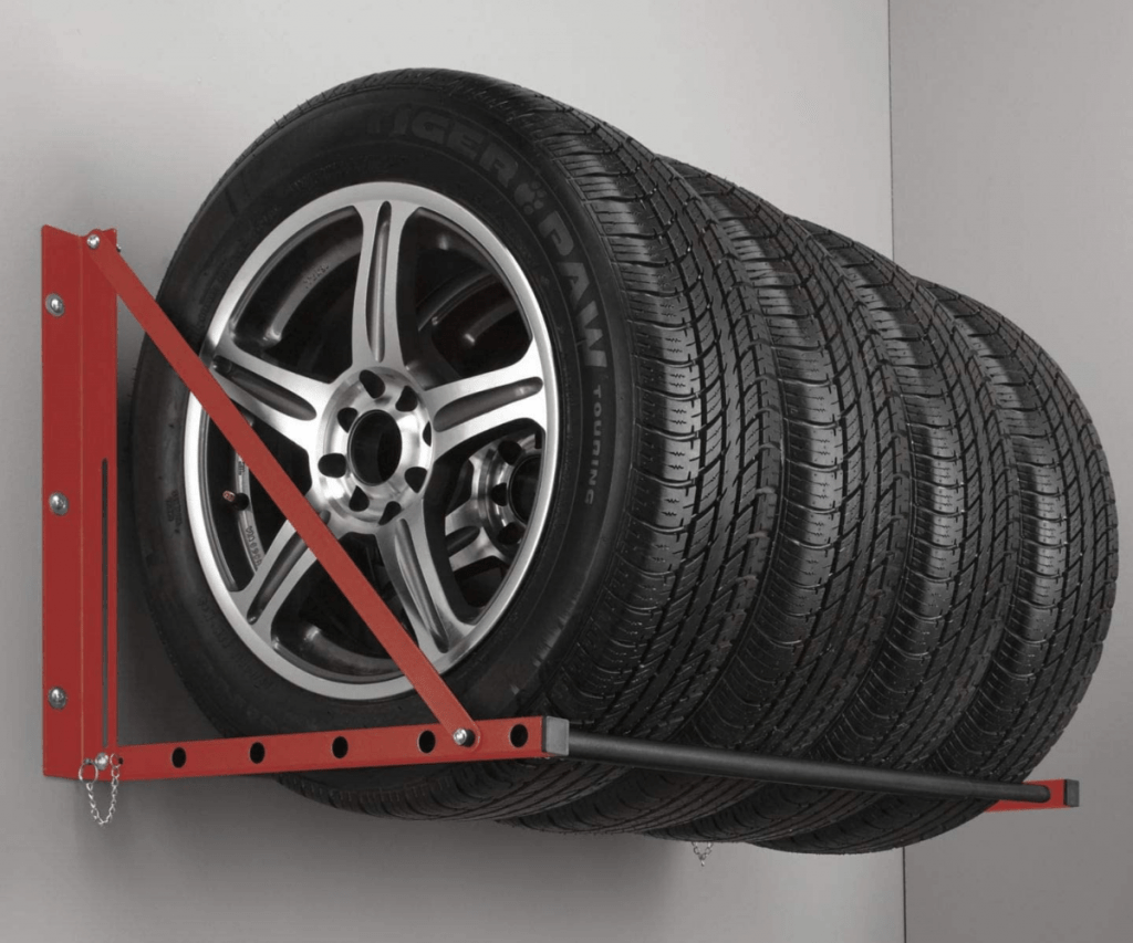 Tires on rims mounted in storage rack.