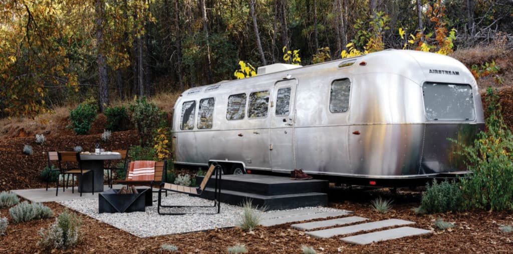 Airstream trailer on wooded, finished campsite at an Autocamp location.