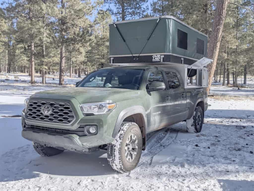 Ford F-150 truck camper in the snow