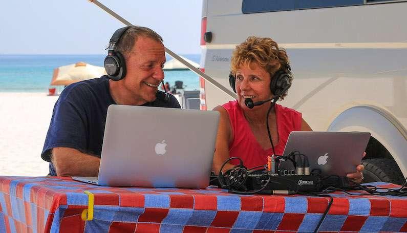 Mike and Jennifer Wendland recording a podcast episode outside