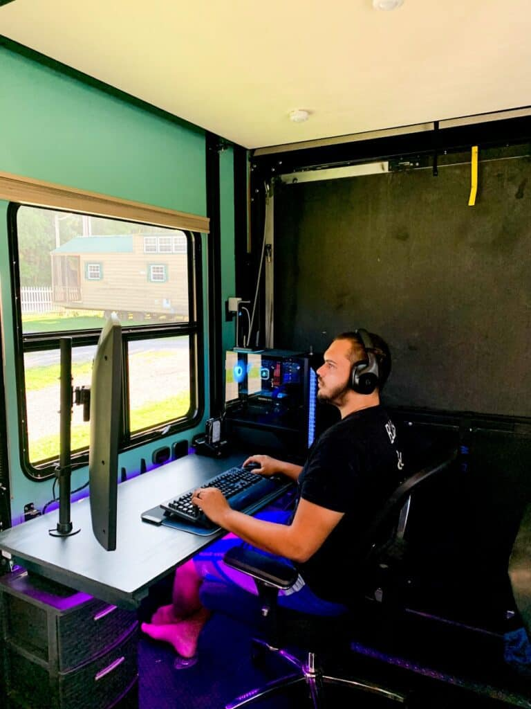 man working at an office in an RV - jobs for full-time RVers