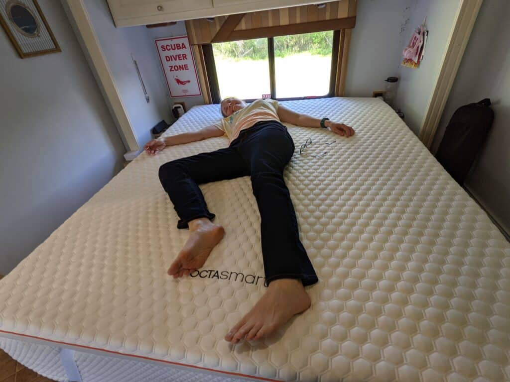 """Natalie laying on the The Premium Mattress Topper by Dormeo® 3"""" Topper."""