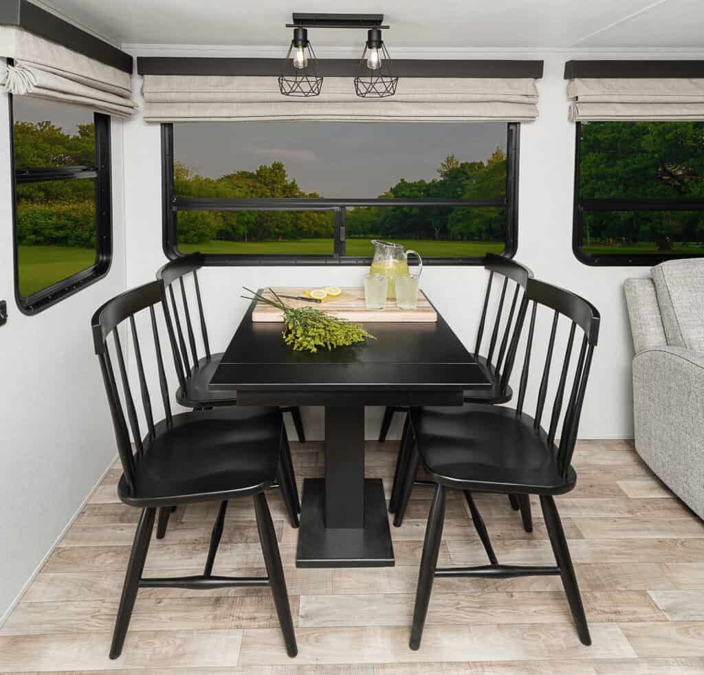 Dining table and chairs inside the 370RL travel trailer.