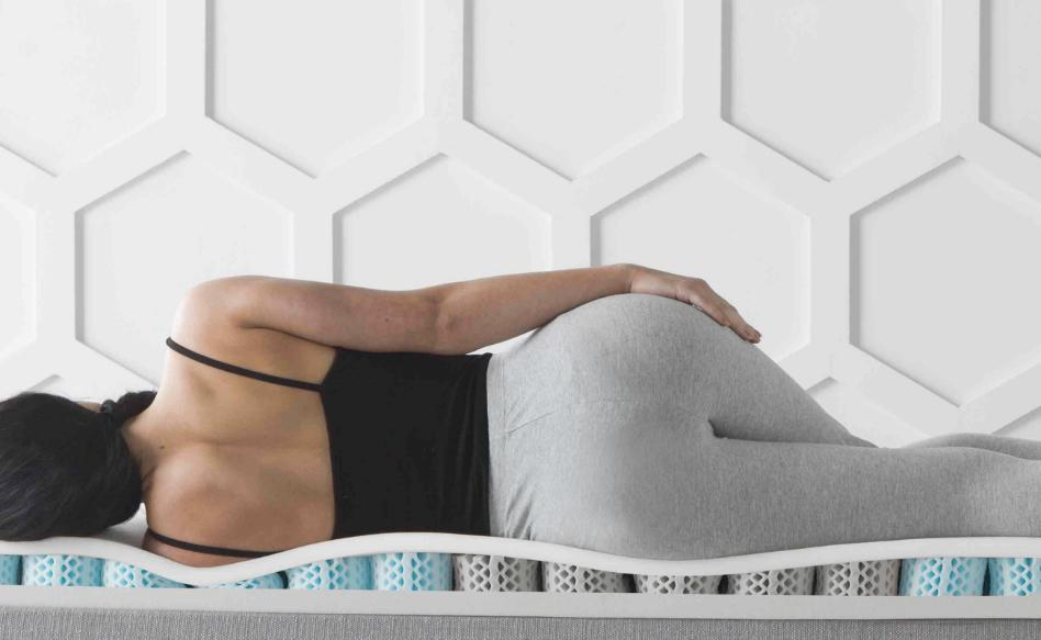 A person laying on the Premium Mattress Topper from Dormeo.