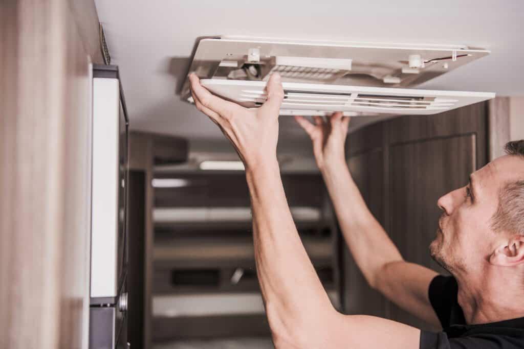 Man installs solar panels to power an RV air conditioner