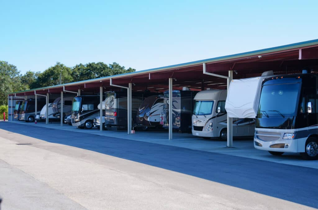 Several RVs in covered storage facility.