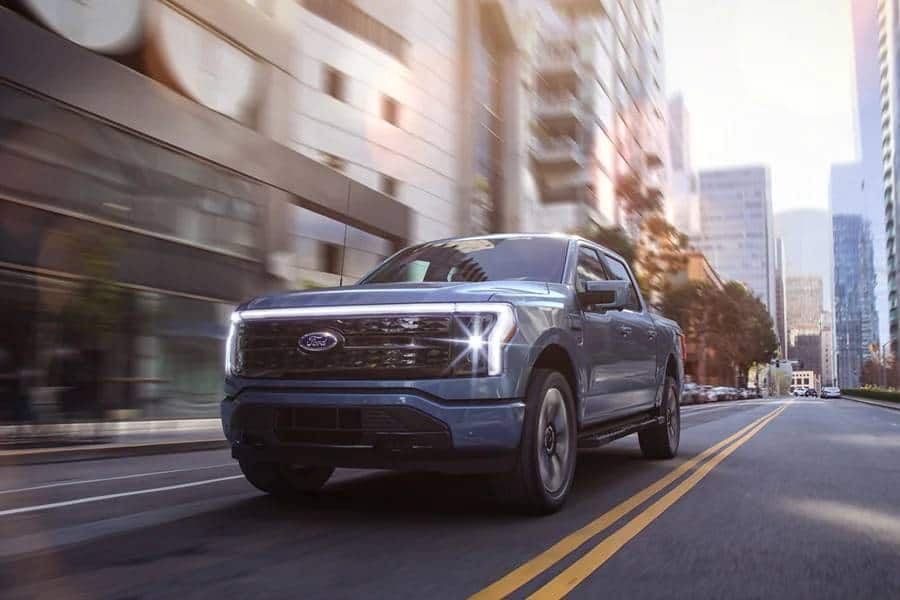 New Ford F-150 Electric Truck driving on city street - can it tow a travel trailer?