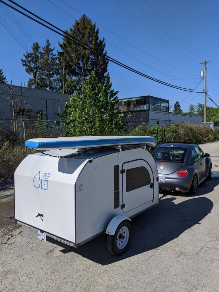 DROPLET trailer being towed by a Volkswagen Bug