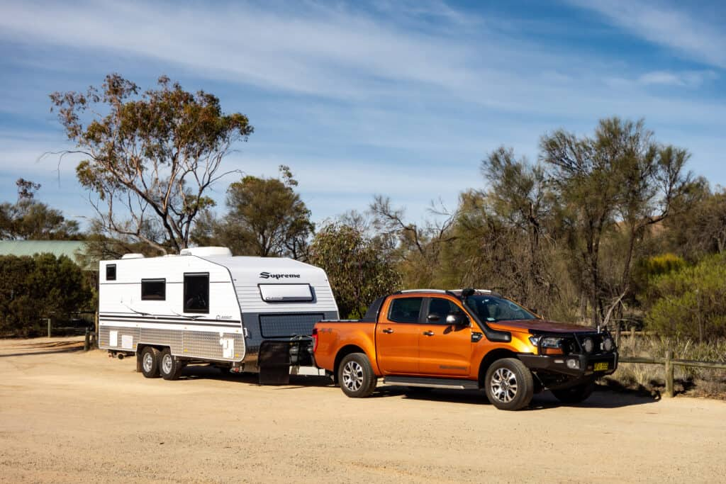 truck and travel trailer at campsite