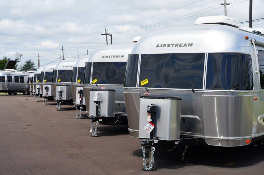 Airstreams for sale at a dealership  -  waiting for RV buyers