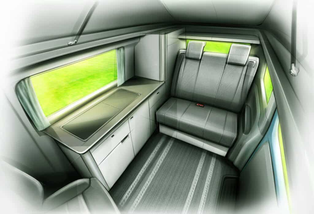 inside the campervan featuring a kitchenette and back seat