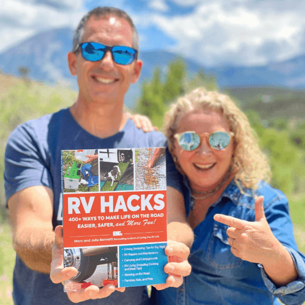Marc and Julie Bennett hold their new book, RV Hacks.