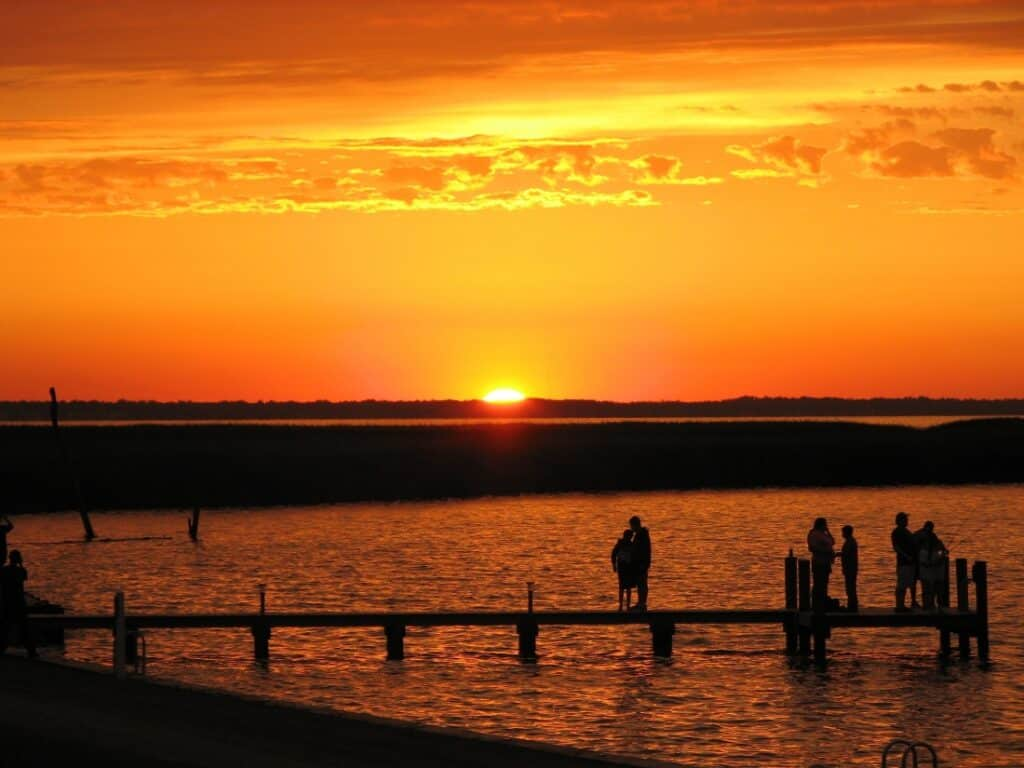 Sunset over a pier at Outer Banks West KOA