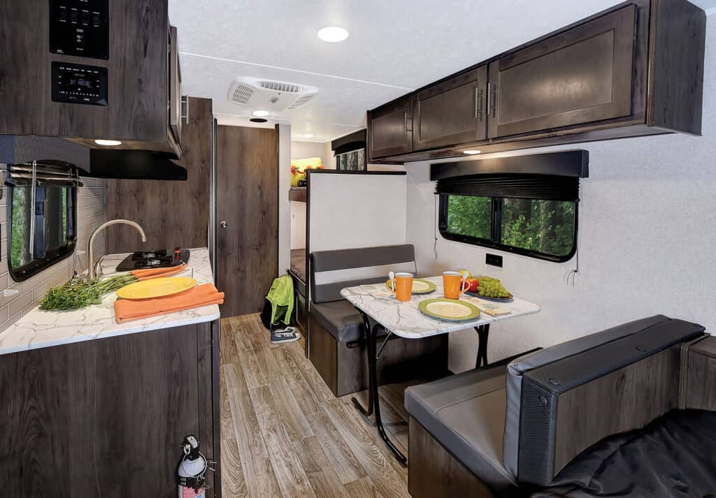 Light colored interior with kitchen and dinette in the Coachmen Viking Ultra-Lite