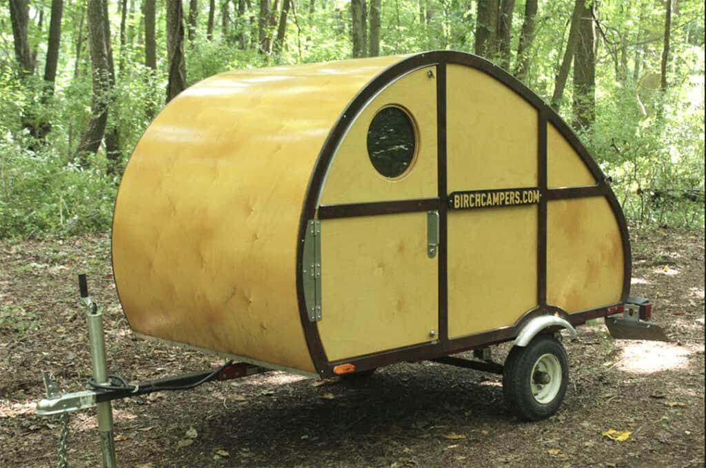 Birch Campers teardrop trailer in the woods. - Teardrop Camper Kits
