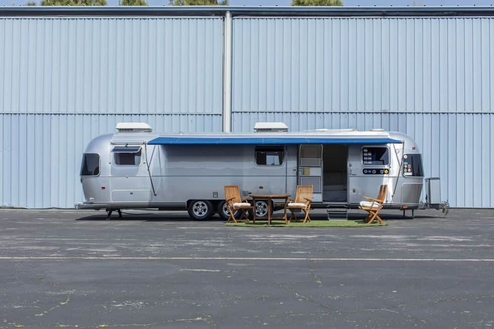 The exterior of Tom Hanks' 1992 Airstream Travel Trailer and outdoor furniture