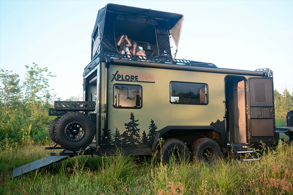 view of the XploreRV XR22 By Imperial Outdoors driving through water