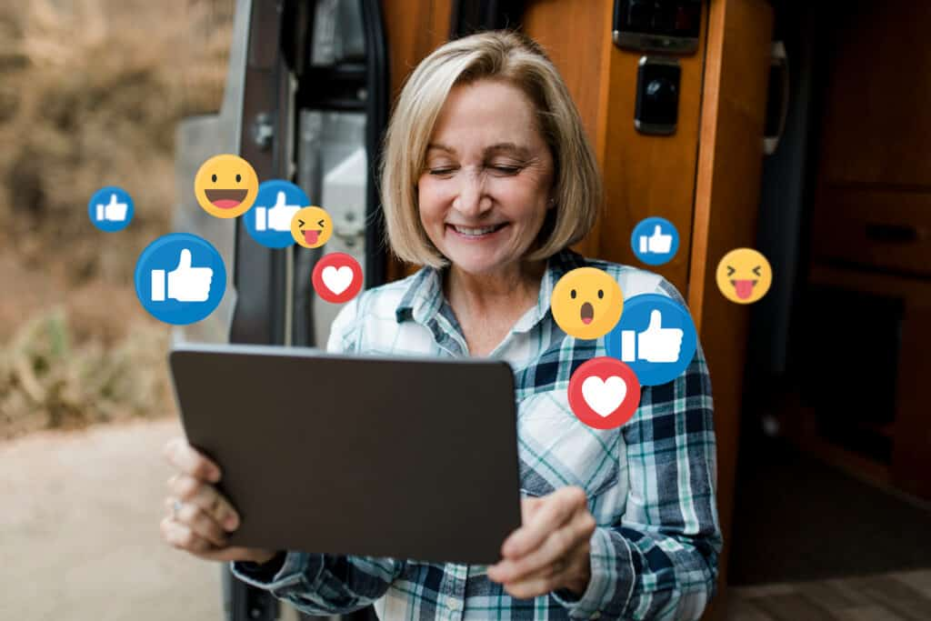 An RVer uses Facebook outside her RV.